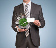 Man hold empty card and Earth with buildings Stock Photos