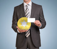 Man hold empty card and jigsaw puzzle sphere Stock Photography