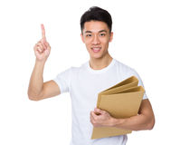 Man hold with folder and finger point up Stock Photos