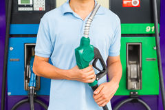 Man hold fuel nozzle to add fuel in car at gas station stock photos