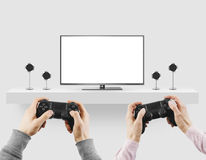 Man hold gamepad in hands in front of blank tv screen mock up pl. Aying game. Clear monitor mockup with gamer first person.rr Stock Photos