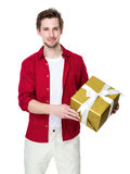 Man hold gift box in hand. Isolated on white background Royalty Free Stock Image