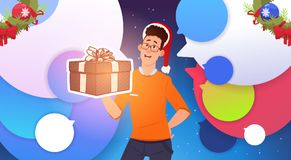 Man Hold Gift Box And Wear Santa Hats Christmas And New Year Holidays Celebration Poster Royalty Free Stock Photography