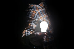 Man hold glow lamp in hand Royalty Free Stock Photography