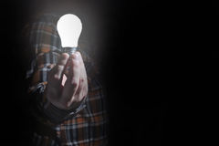 Man hold glow lamp in hand Royalty Free Stock Image