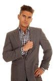 Man hold gray jacket very serious Stock Photos