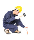 Man hold hammer and cold chisel on white Royalty Free Stock Photo