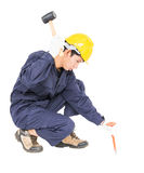 Man hold hammer and cold chisel on white Royalty Free Stock Image