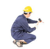 Man hold hammer and cold chisel on white Royalty Free Stock Photos