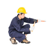Man hold hammer and cold chisel on white Stock Image