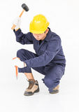 Man hold hammer and cold chisel on white Stock Photos