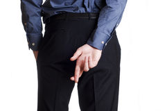 Man hold and hide on his back his cross fingers Royalty Free Stock Images