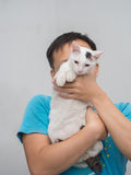 Man Hold His Cat Up Royalty Free Stock Photos