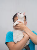 Man Hold His Cat Up Stock Photo