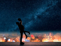 Man hold his girlfriend up above the city. Silhouette of Asian couple, men hold his girlfriend up above the city in night under stars Stock Photography