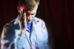 Man hold his had and suffering from headache, pain, migraine, sa Stock Photo