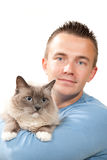 Man hold his lovely Ragdoll cat. Young handsome man hold his lovely Ragdoll cat with blue eye isolated on a white background Royalty Free Stock Photography