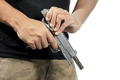 Man hold and loading gun ammunition. Close up of man`s hand reloading gun, Man hold and loading ammunition his pistol on white background. Army, Semi-automatic royalty free stock photography