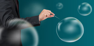 Man hold needle stab empty bubble Royalty Free Stock Images
