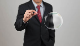 Man hold needle stab empty bubble Royalty Free Stock Image