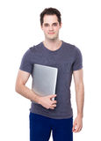 Man hold with notebook computer Stock Photo