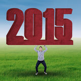 Man hold number 2015 Royalty Free Stock Image