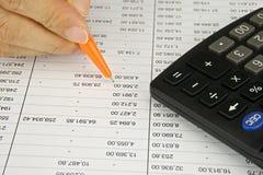 Man hold orange pen  planning finance Royalty Free Stock Photos