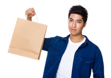 Man hold with paper bag Stock Image