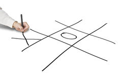 Man hold pen drawing Tic-Tac-Toe game on white Royalty Free Stock Photo