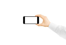 Man hold phone blank screen mockup in hand, taking photo Royalty Free Stock Photo
