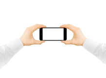 Man hold phone blank screen mockup in two hands, taking photo Stock Images