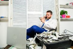 Man hold plastic bank card. Man successful businessman phone conversation ask service. Businessman rich bearded guy sit. Office with lot of cash money. Bank stock photo