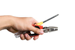Man hold pliers and screwdriver isolate on white background Stock Photography