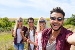 Man hold smart phone camera taking selfie photo friends face smile close up Royalty Free Stock Photography