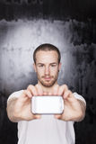 Man hold smartphone in hands Stock Photo