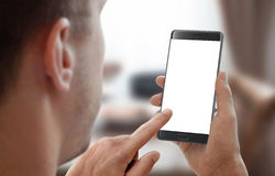 Man hold smartphone in room interior. Royalty Free Stock Photos