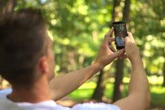 Man hold smartphone Stock Photo