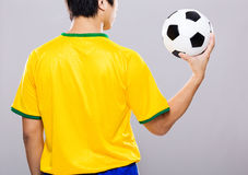 Man hold soccer ball on hand palm Royalty Free Stock Photo
