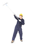Man hold squeegee window cleaner isolated on white Stock Photo