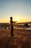 Man hold the sun using his hand Royalty Free Stock Images