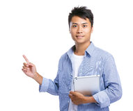 Man hold tablet and finger point up Stock Image