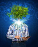 Man hold tablet pc. Green tree instead his head Stock Image