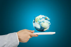 Man Hold Tablet showing Earth Stock Photo