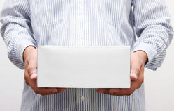 Man hold white paper box. Man holding white paper box Royalty Free Stock Images