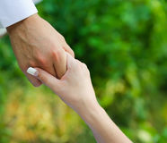 Man hold a woman fingers by the hand Stock Image