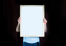 Man hold Wood frame, mock up, on the black background stock image