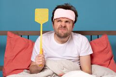 Free Man Holding A Fly Swatter Wanting To Kill Annoying Mosquito Stock Photography - 176607482