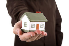 Man Holding A House In His Hand Stock Photo