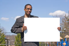 Man Holding A Sign Stock Photo