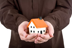 Man Holding A Small House Stock Images